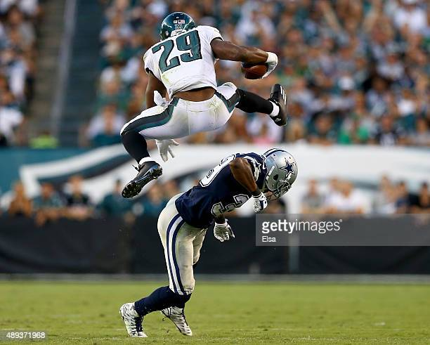 DeMarco Murray of the Philadelphia Eagles leaps over Brandon Carr of the Dallas Cowboys in the third quarter on September 20 2014 at Lincoln...