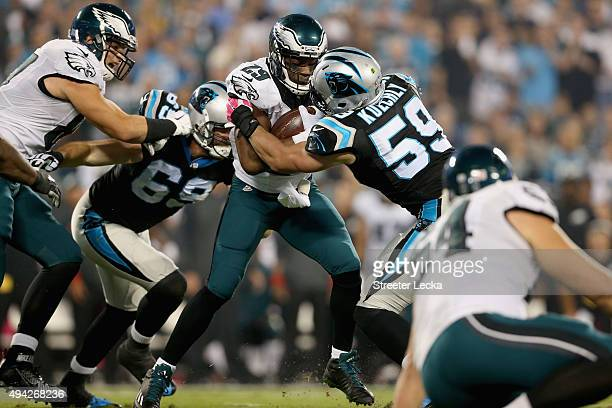 DeMarco Murray of the Philadelphia Eagles rushes the ball against Luke Kuechly of the Carolina Panthers in the 1st quarter during their game at Bank...