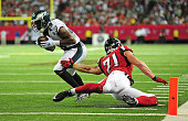 DeMarco Murray of the Philadelphia Eagles scores a third quarter touchdown after putting a move on Kroy Biermann of the Atlanta Falcons at the...