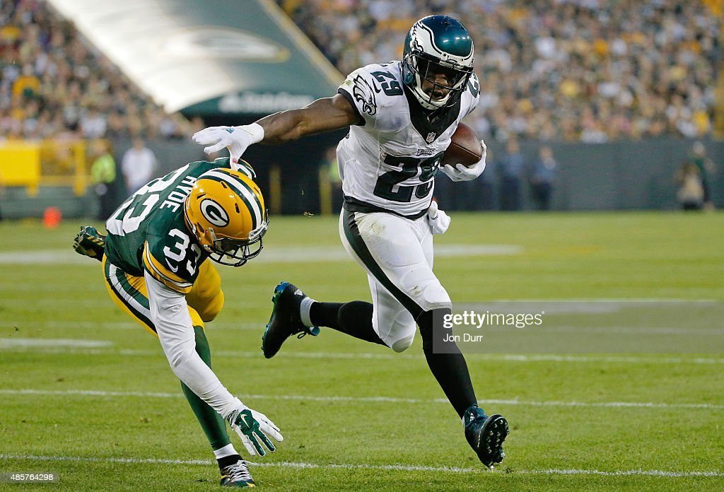DeMarco Murray of the Philadelphia Eagles stiff arms Micah Hyde of the Green Bay Packers during the first quarter of a preseason game at Lambeau...