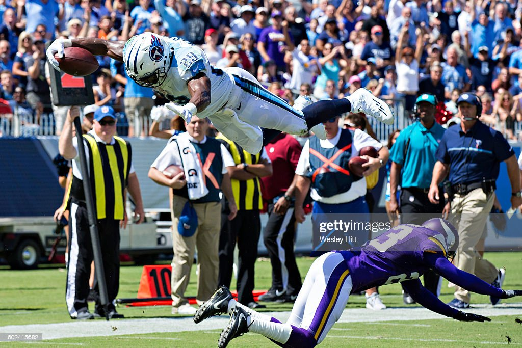DeMarco Murray #29 of the Tennessee Titans dives over Terence Newman #23 of the Minnesota Vikings into the end zone for a touchdown during the first half of the game at Nissan Stadium on September 11, 2016 in Nashville, Tennessee.