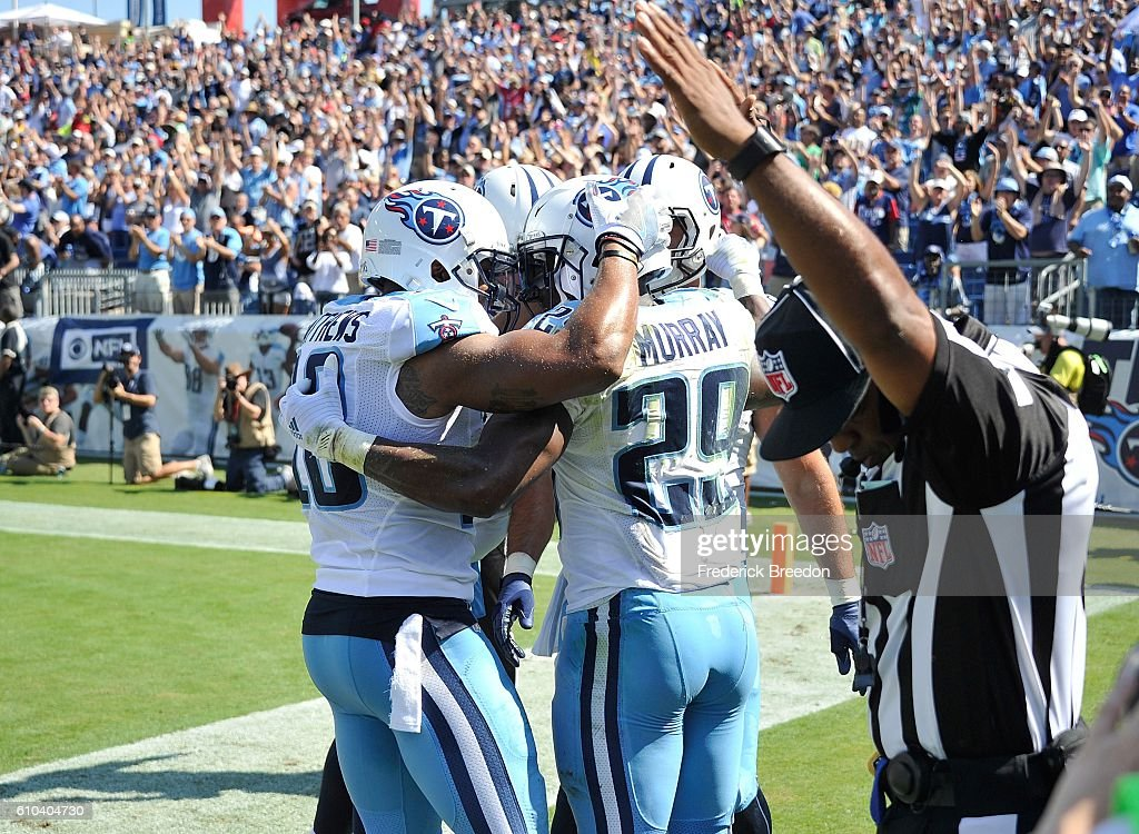 DeMarco Murray #29 of the Tennessee Titans is congratulated by teammates after scoring a touchdown against the Oakland Raiders during the second half at Nissan Stadium on September 25, 2016 in Nashville, Tennessee.