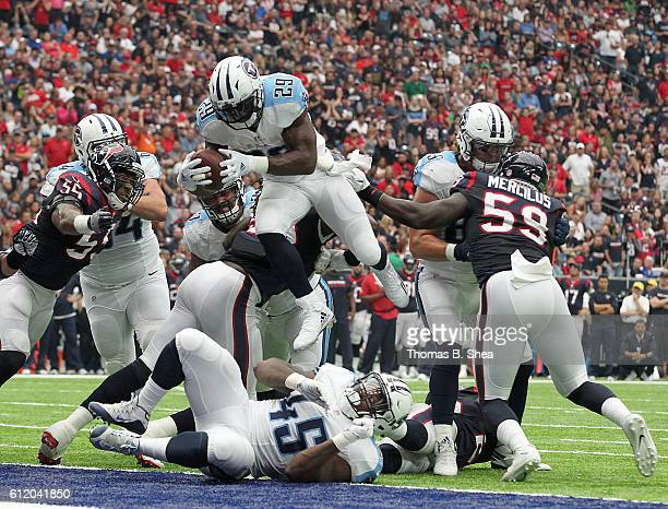 DeMarco Murray of the Tennessee Titans leaps over the Houston Texans defensive line for a touchdown in the second quarter during the NFL game between...