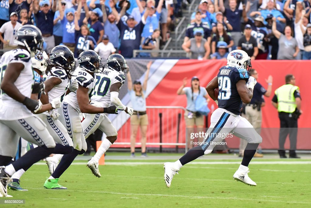 DeMarco Murray #29 of the Tennessee Titans runs past a group of the Seattle Seahawks for a touchdown during the second half at Nissan Stadium on September 24, 2017 in Nashville, Tennessee.