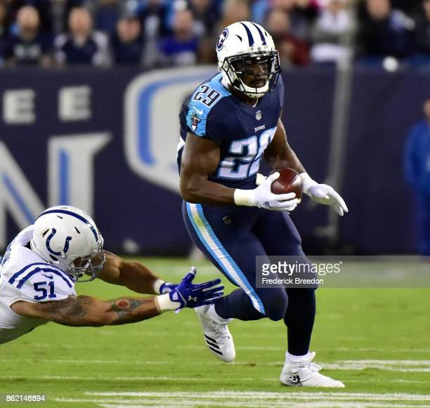DeMarco Murray of the Tennessee Titans rushes against John Simon of the Indianapolis Colts during the first half at Nissan Stadium on October 16 2017...