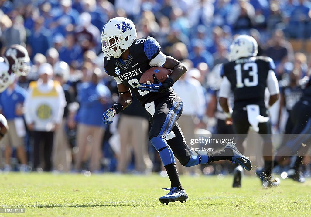 Demarco Robinson #9 of the Kentucky Wildcats runs with the ball during the SEC game against the Mississippi State Bulldogs at Commonwealth Stadium on October 6, 2012 in Lexington, Kentucky.