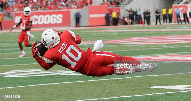 Demarcus Ayers of the Houston Cougars catches a pass that was deflected by Navy at TEDECU Stadium on November 27 2015 in Houston Texas