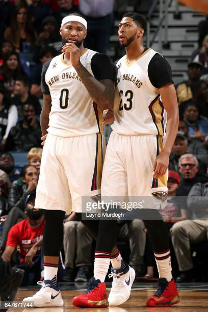 DeMarcus Cousins and Anthony Davis of the New Orleans Pelicans looks on during the game against the San Antonio Spurs on March 3 2017 at the Smoothie...