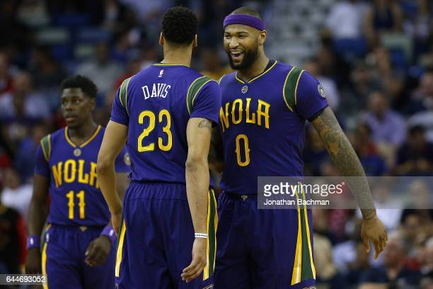 DeMarcus Cousins and Anthony Davis of the New Orleans Pelicans react during the first half of a game against the Houston Rockets at the Smoothie King...
