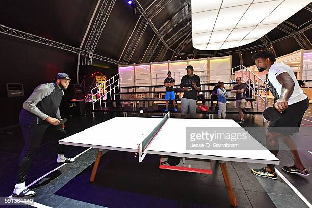 DeMarcus Cousins and DeAndre Jordan of the USA Basketball Men's National Team play ping pong while visiting the Team Nike House during the Rio 2016...