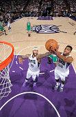 DeMarcus Cousins and Jason Thompson of the Sacramento Kings rebound against the Boston Celtics on February 20 2015 at Sleep Train Arena in Sacramento...