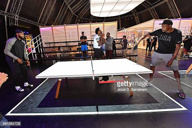 DeMarcus Cousins and Kevin Durant of the USA Basketball Men's National Team play ping pong while visiting the Team Nike House during the Rio 2016...