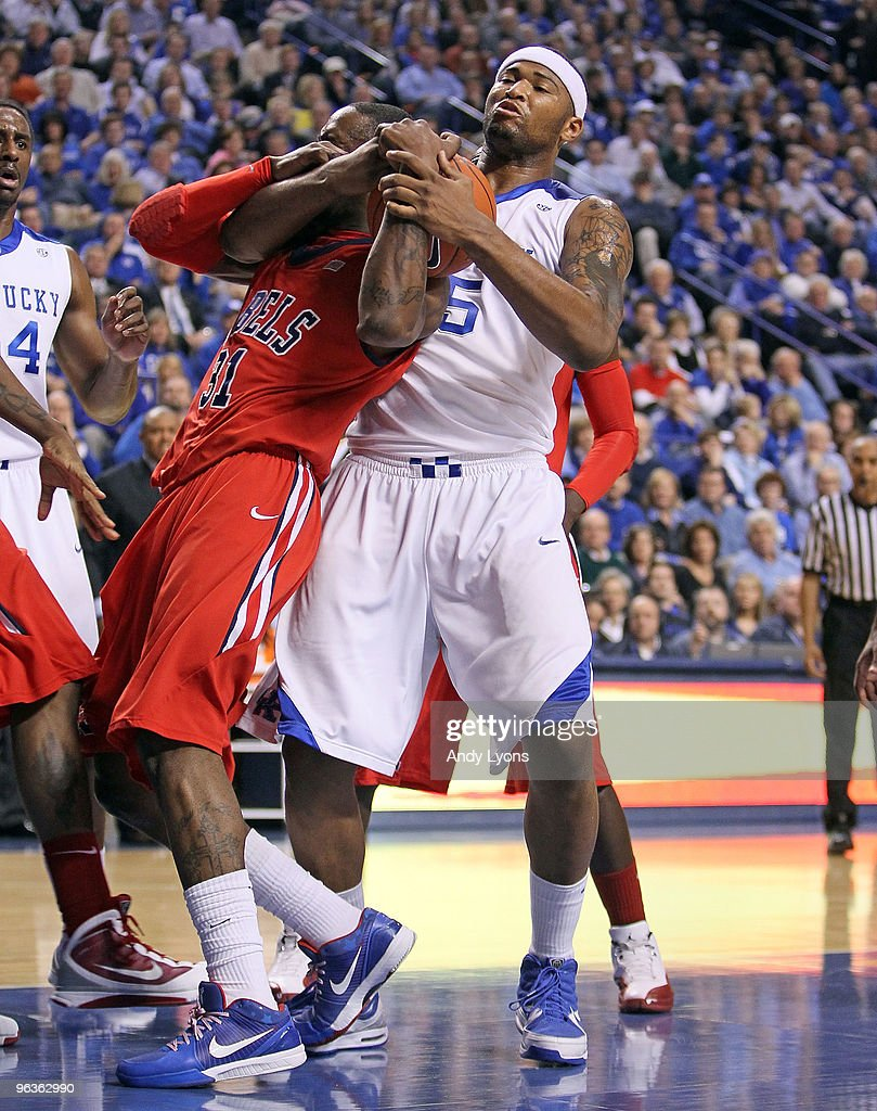 DeMarcus Cousins of the Kentucky Wildcats and Murphy Holloway of the Ole Miss Rebels battle for a rebound during the SEC game on February 2 2010 at...