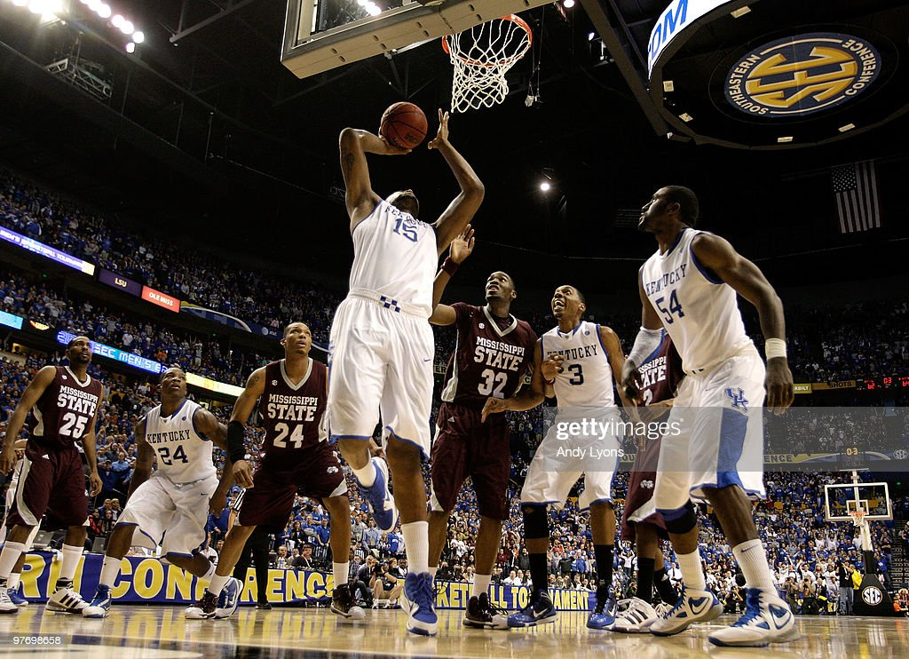 DeMarcus Cousins #15 of the Kentucky Wildcats makes a 2-point basket at the end of regulatio to tie the game and send it into overtime against Jarvis Varnado #32 of the Mississippi State Bulldogs during the final of the SEC Men's Basketball Tournament at the Bridgestone Arena on March 14, 2010 in Nashville, Tennessee.