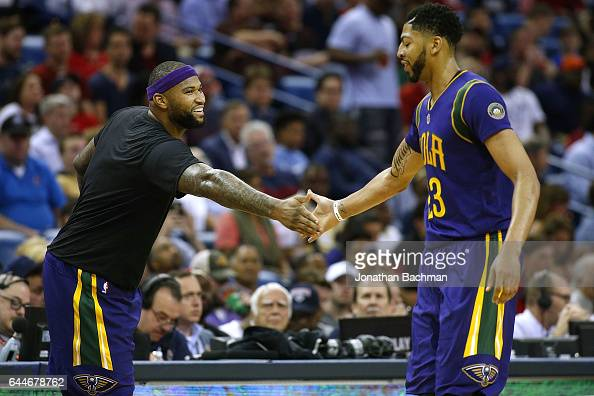 DeMarcus Cousins of the New Orleans Pelicans and Anthony Davis react during the first half of a game against the Houston Rockets at the Smoothie King...