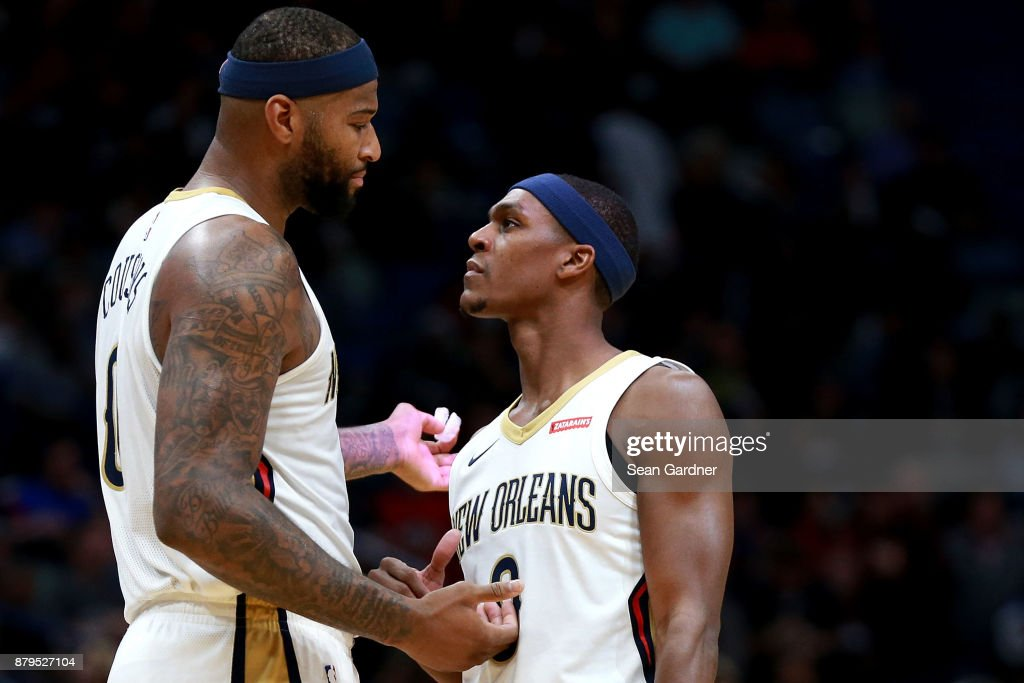 DeMarcus Cousins #0 of the New Orleans Pelicans and Rajon Rondo #9 of the New Orleans Pelicans talk on the court during the first half of a NBA game against the San Antonio Spurs at the Smoothie King Center on November 22, 2017 in New Orleans, Louisiana.