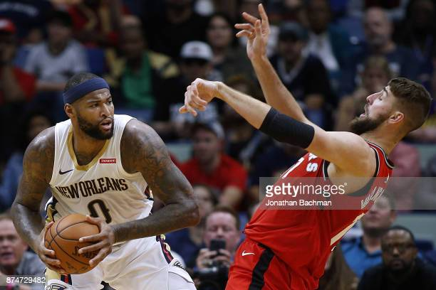 DeMarcus Cousins of the New Orleans Pelicans drives against Jonas Valanciunas of the Toronto Raptors during the second half of a game at the Smoothie...