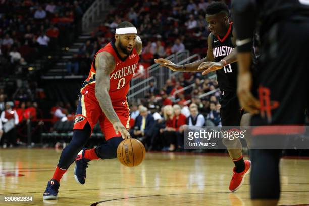 DeMarcus Cousins of the New Orleans Pelicans drives to the basket defended by Clint Capela of the Houston Rockets in the second half at Toyota Center...