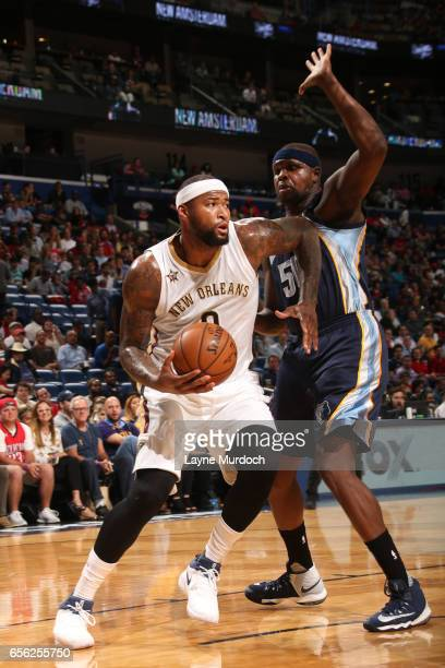 DeMarcus Cousins of the New Orleans Pelicans handles the ball during a game against the Memphis Grizzlies on March 21 2017 at Smoothie King Center in...