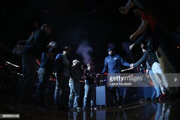 DeMarcus Cousins of the New Orleans Pelicans high fives fans before the game against the Philadelphia 76ers on December 10 2017 at the Smoothie King...