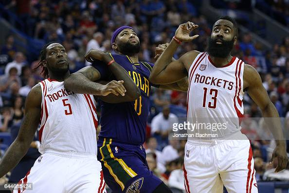 DeMarcus Cousins of the New Orleans Pelicans Montrezl Harrell of the Houston Rockets and James Harden go for a rebound during the first half of a...