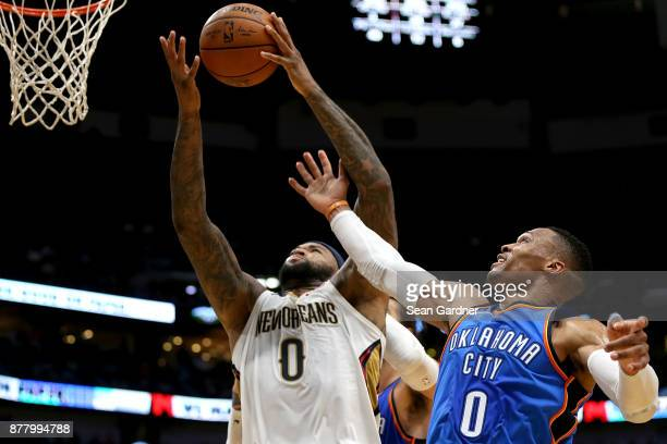 DeMarcus Cousins of the New Orleans Pelicans out rebounds Russell Westbrook of the Oklahoma City Thunder during a NBA game at the Smoothie King...