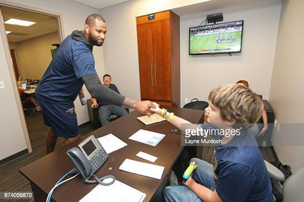 DeMarcus Cousins of the New Orleans Pelicans participates in a game day experience with Ochsner Health System Hero of the Game Allen Dedon before the...
