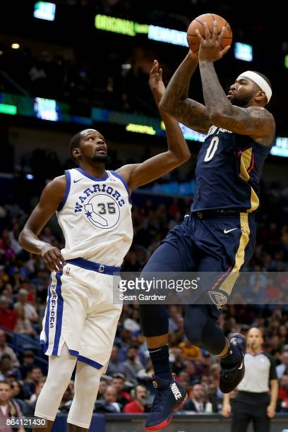 DeMarcus Cousins of the New Orleans Pelicans shoots over Kevin Durant of the Golden State Warriors during the first half at Smoothie King Center on...