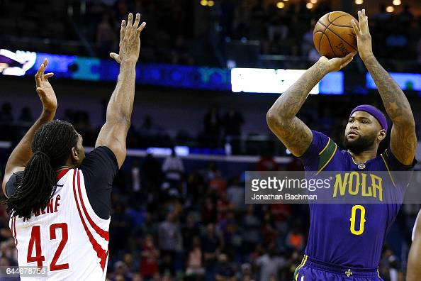 DeMarcus Cousins of the New Orleans Pelicans shoots over Nene Hilario of the Houston Rockets during the first half of a game at the Smoothie King...