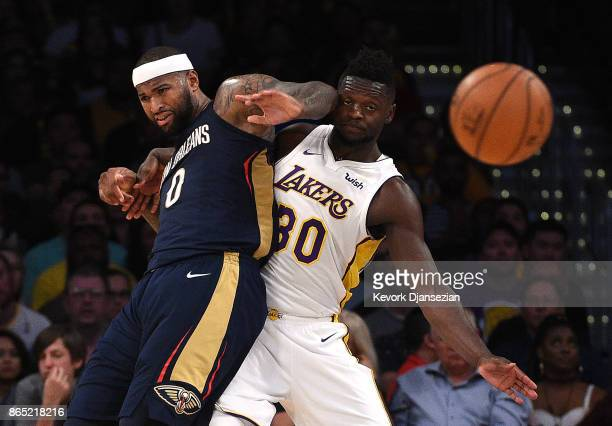 DeMarcus Cousins of the New Orleans Pelicans throws an elbow as he is defended by Julius Randle of the Los Angeles Lakers during the second half...