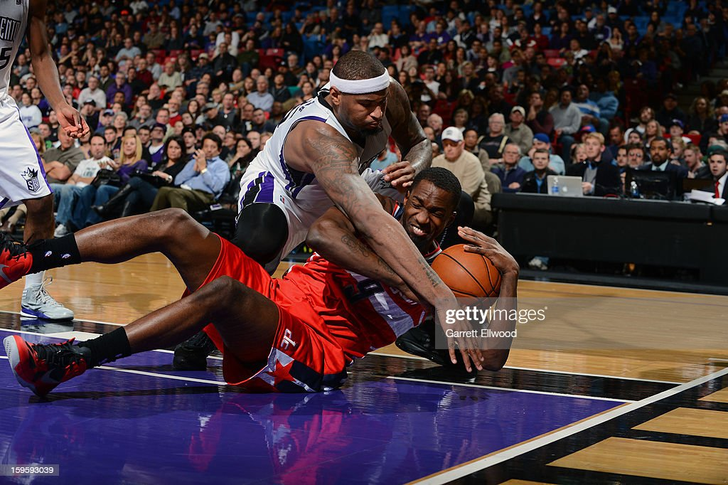 <a gi-track='captionPersonalityLinkClicked' href=/galleries/search?phrase=DeMarcus+Cousins&family=editorial&specificpeople=5792008 ng-click='$event.stopPropagation()'>DeMarcus Cousins</a> #15 of the Sacramento Kings and <a gi-track='captionPersonalityLinkClicked' href=/galleries/search?phrase=Martell+Webster&family=editorial&specificpeople=601785 ng-click='$event.stopPropagation()'>Martell Webster</a> #9 of the Washington Wizards scramble for the loose ball on January 16, 2013 at Sleep Train Arena in Sacramento, California.