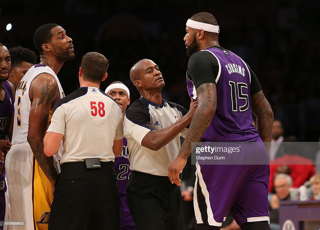 DeMarcus Cousins of the Sacramento Kings and Shawne Williams of the Los Angeles Lakers exchange words during an altercation in the game at Staples...
