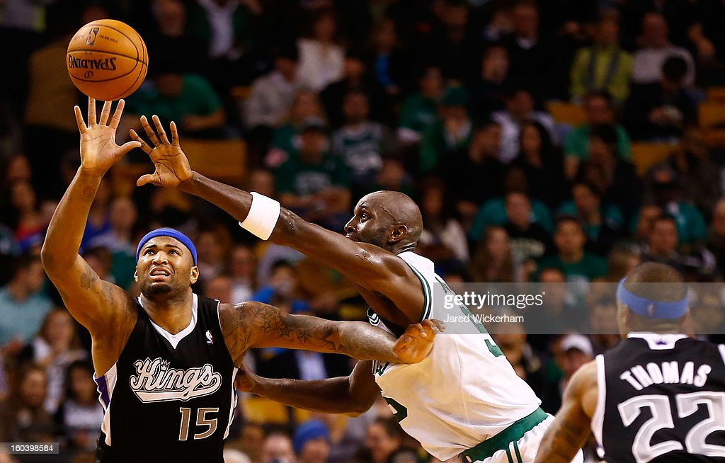 DeMarcus Cousins #15 of the Sacramento Kings attempts to corral a pass in front of Kevin Garnett #5 of the Boston Celtics during the game on January 30, 2013 at TD Garden in Boston, Massachusetts.
