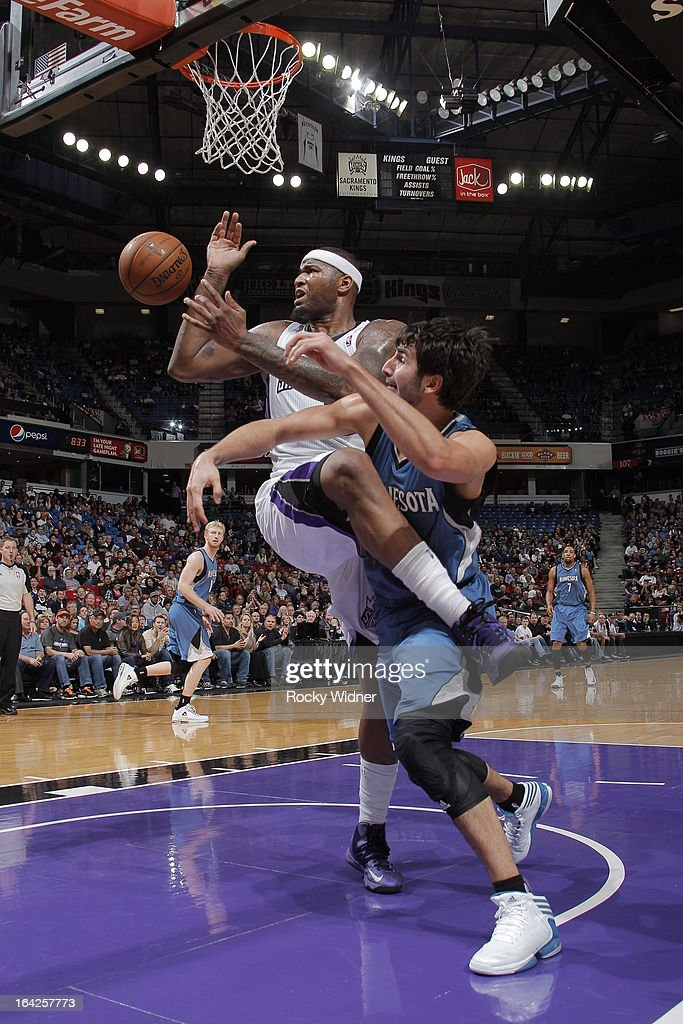 DeMarcus Cousins #15 of the Sacramento Kings battles for a loose ball against Ricky Rubio #9 of the Minnesota Timberwolves on March 21, 2013 at Sleep Train Arena in Sacramento, California.