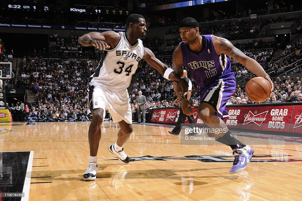 DeMarcus Cousins #15 of the Sacramento Kings drives against Antonio McDyess #34 of the San Antonio Spurs on March 11, 2011 at AT&T Center in San Antonio, Texas.