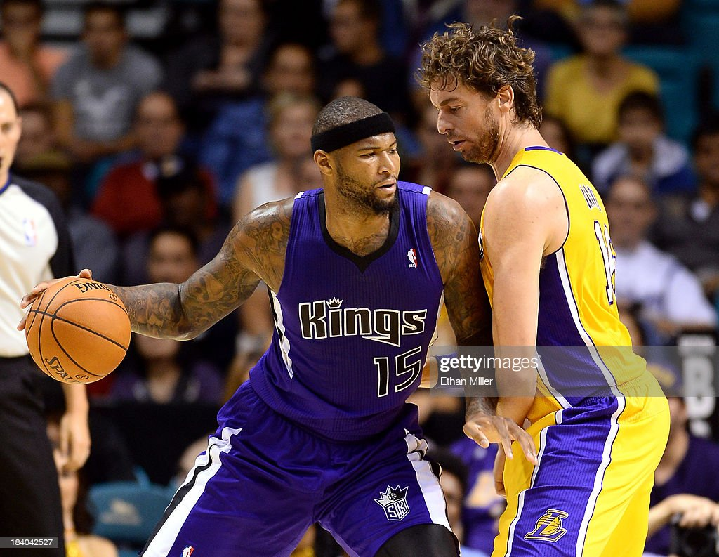 DeMarcus Cousins #15 of the Sacramento Kings drives against Pau Gasol #16 of the Los Angeles Lakers during their preseason game at the MGM Grand Garden Arena on October 10, 2013 in Las Vegas, Nevada. Sacramento won 104-86.