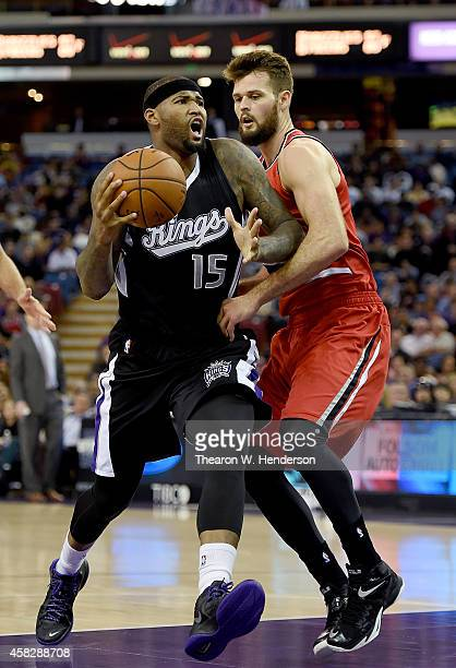 DeMarcus Cousins of the Sacramento Kings drives on Joel Freeland of the Portland Trail Blazers during the first half of their game at Sleep Train...