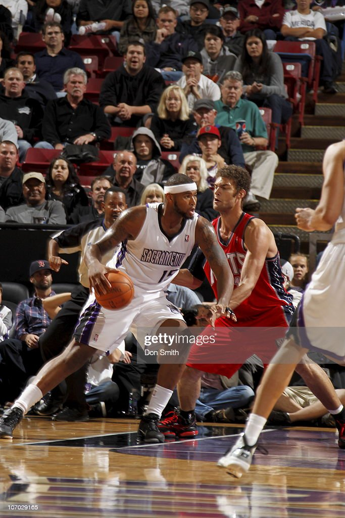 <a gi-track='captionPersonalityLinkClicked' href=/galleries/search?phrase=DeMarcus+Cousins&family=editorial&specificpeople=5792008 ng-click='$event.stopPropagation()'>DeMarcus Cousins</a> #15 of the Sacramento Kings drives to the basket against <a gi-track='captionPersonalityLinkClicked' href=/galleries/search?phrase=Brook+Lopez&family=editorial&specificpeople=3847328 ng-click='$event.stopPropagation()'>Brook Lopez</a> #11 of the New Jersey Nets on November 19, 2010 at ARCO Arena in Sacramento, California.