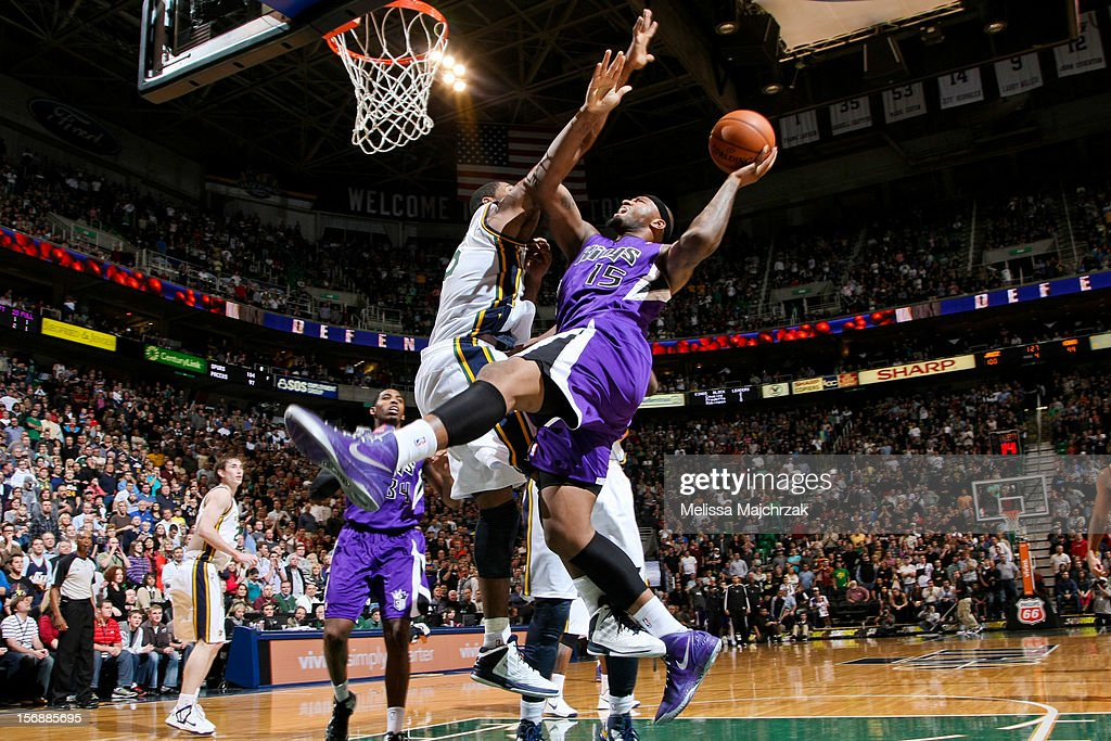 DeMarcus Cousins #15 of the Sacramento Kings drives to the basket against Derrick Favors #15 of the Utah Jazz at Energy Solutions Arena on November 23, 2012 in Salt Lake City, Utah.