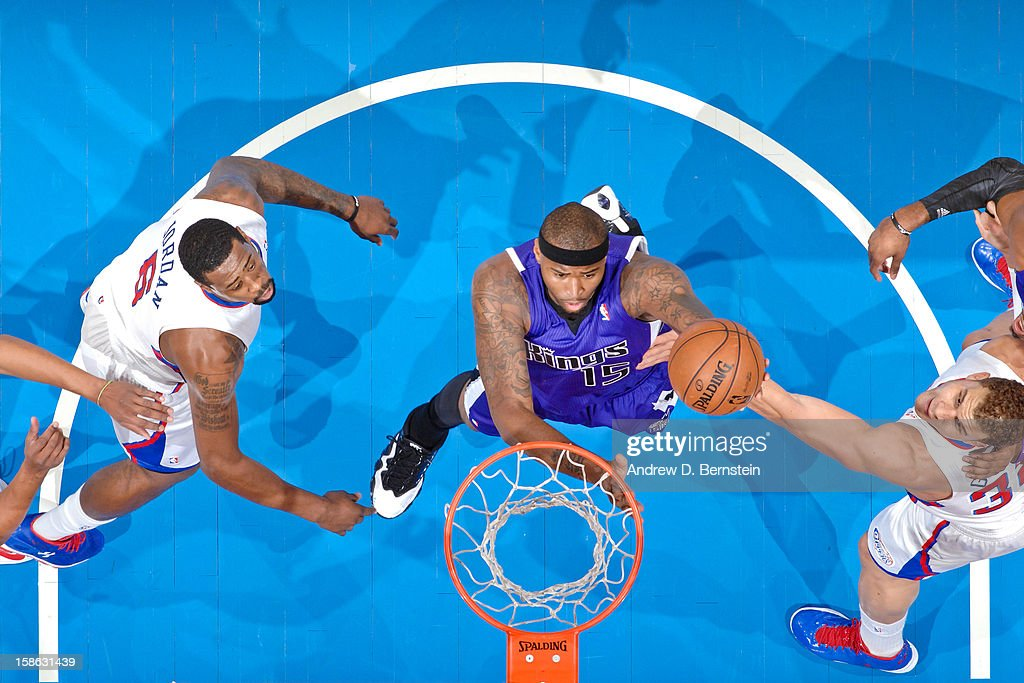 DeMarcus Cousins #15 of the Sacramento Kings drives to the basket against Blake Griffin #32 and DeAndre Jordan #6 of the Los Angeles Clippers at Staples Center on December 21, 2012 in Los Angeles, California.