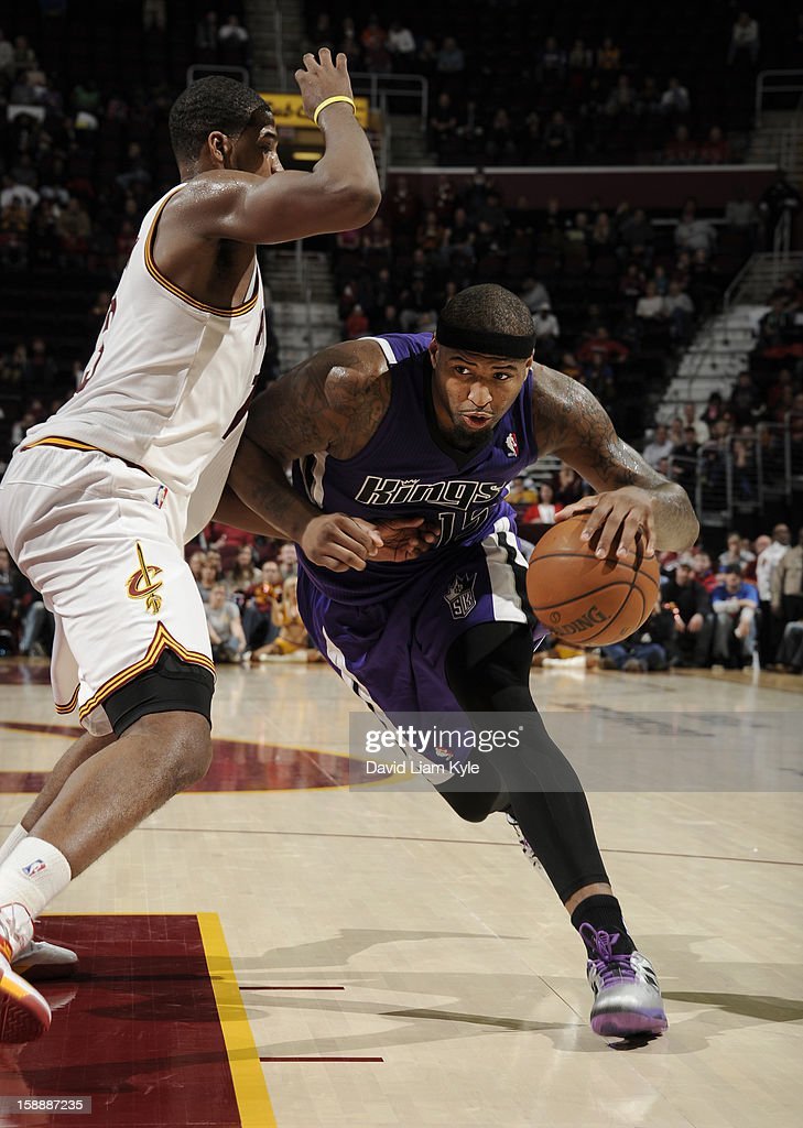 <a gi-track='captionPersonalityLinkClicked' href=/galleries/search?phrase=DeMarcus+Cousins&family=editorial&specificpeople=5792008 ng-click='$event.stopPropagation()'>DeMarcus Cousins</a> #15 of the Sacramento Kings drives to the basket against <a gi-track='captionPersonalityLinkClicked' href=/galleries/search?phrase=Tristan+Thompson&family=editorial&specificpeople=5799092 ng-click='$event.stopPropagation()'>Tristan Thompson</a> #13 of the Cleveland Cavaliers at The Quicken Loans Arena on January 2, 2013 in Cleveland, Ohio.