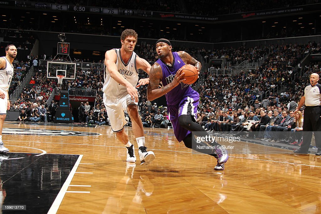DeMarcus Cousins #15 of the Sacramento Kings drives to the basket against Brook Lopez #11 of the Brooklyn Nets on January 5, 2013 at the Barclays Center in the Brooklyn borough of New York City.