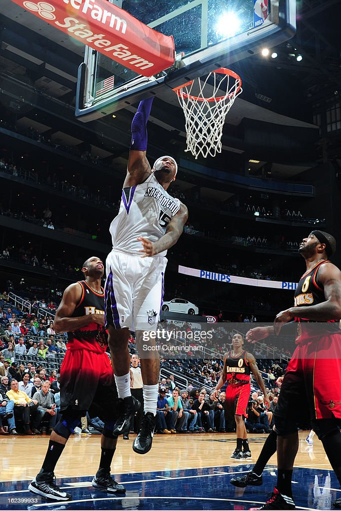 <a gi-track='captionPersonalityLinkClicked' href=/galleries/search?phrase=DeMarcus+Cousins&family=editorial&specificpeople=5792008 ng-click='$event.stopPropagation()'>DeMarcus Cousins</a> #15 of the Sacramento Kings dunks against <a gi-track='captionPersonalityLinkClicked' href=/galleries/search?phrase=Al+Horford&family=editorial&specificpeople=699030 ng-click='$event.stopPropagation()'>Al Horford</a> #15 and <a gi-track='captionPersonalityLinkClicked' href=/galleries/search?phrase=Josh+Smith+-+Basketball+Player+-+Born+1985&family=editorial&specificpeople=201983 ng-click='$event.stopPropagation()'>Josh Smith</a> #5 of the Atlanta Hawks on February 22, 2013 at Philips Arena in Atlanta, Georgia.