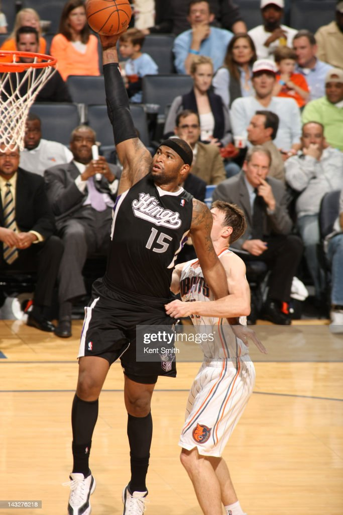 <a gi-track='captionPersonalityLinkClicked' href=/galleries/search?phrase=DeMarcus+Cousins&family=editorial&specificpeople=5792008 ng-click='$event.stopPropagation()'>DeMarcus Cousins</a> #15 of the Sacramento Kings dunks against <a gi-track='captionPersonalityLinkClicked' href=/galleries/search?phrase=Matt+Carroll+-+Basketball+Player&family=editorial&specificpeople=213200 ng-click='$event.stopPropagation()'>Matt Carroll</a> #33 of the Charlotte Bobcats at the Time Warner Cable Arena on April 22, 2012 in Charlotte, North Carolina.