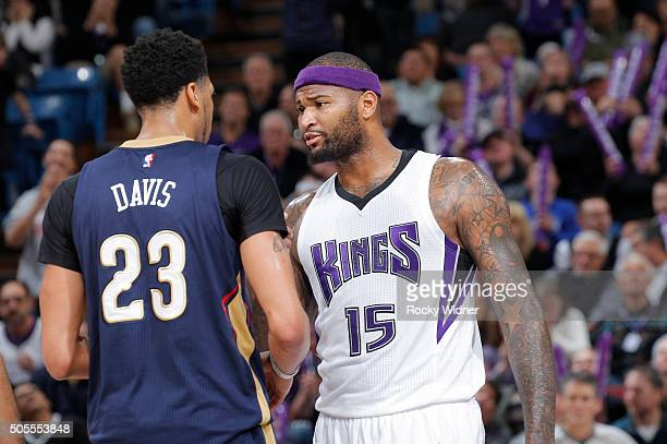 DeMarcus Cousins of the Sacramento Kings faces off against Anthony Davis of the New Orleans Pelicans on January 13 2016 at Sleep Train Arena in...