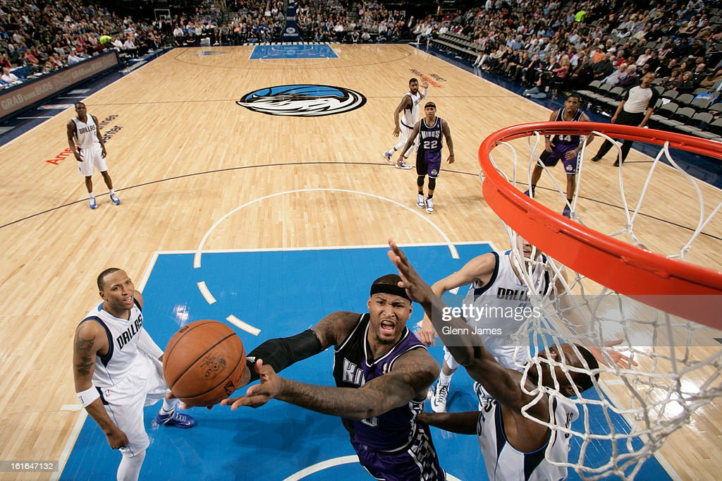 DeMarcus Cousins #15 of the Sacramento Kings goes in for the layup against Bernard James #5 of the Dallas Mavericks on February 13, 2013 at the American Airlines Center in Dallas, Texas.