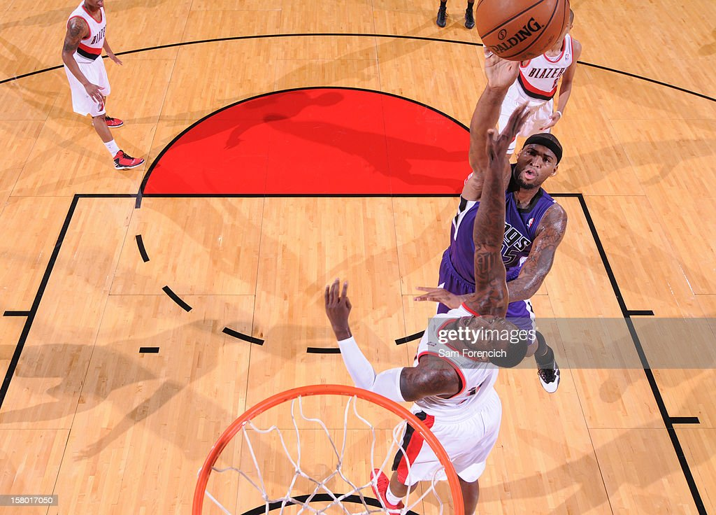 <a gi-track='captionPersonalityLinkClicked' href=/galleries/search?phrase=DeMarcus+Cousins&family=editorial&specificpeople=5792008 ng-click='$event.stopPropagation()'>DeMarcus Cousins</a> #15 of the Sacramento Kings goes to the basket against <a gi-track='captionPersonalityLinkClicked' href=/galleries/search?phrase=J.J.+Hickson&family=editorial&specificpeople=4226173 ng-click='$event.stopPropagation()'>J.J. Hickson</a> #21 of the Portland Trail Blazers during the game between the Sacramento Kings and the Portland Trail Blazers on December 8, 2012 at the Rose Garden Arena in Portland, Oregon.