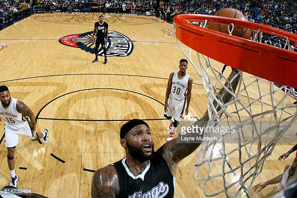 DeMarcus Cousins of the Sacramento Kings goes to the basket against the New Orleans Pelicans on March 7 2016 at the Smoothie King Center in New...