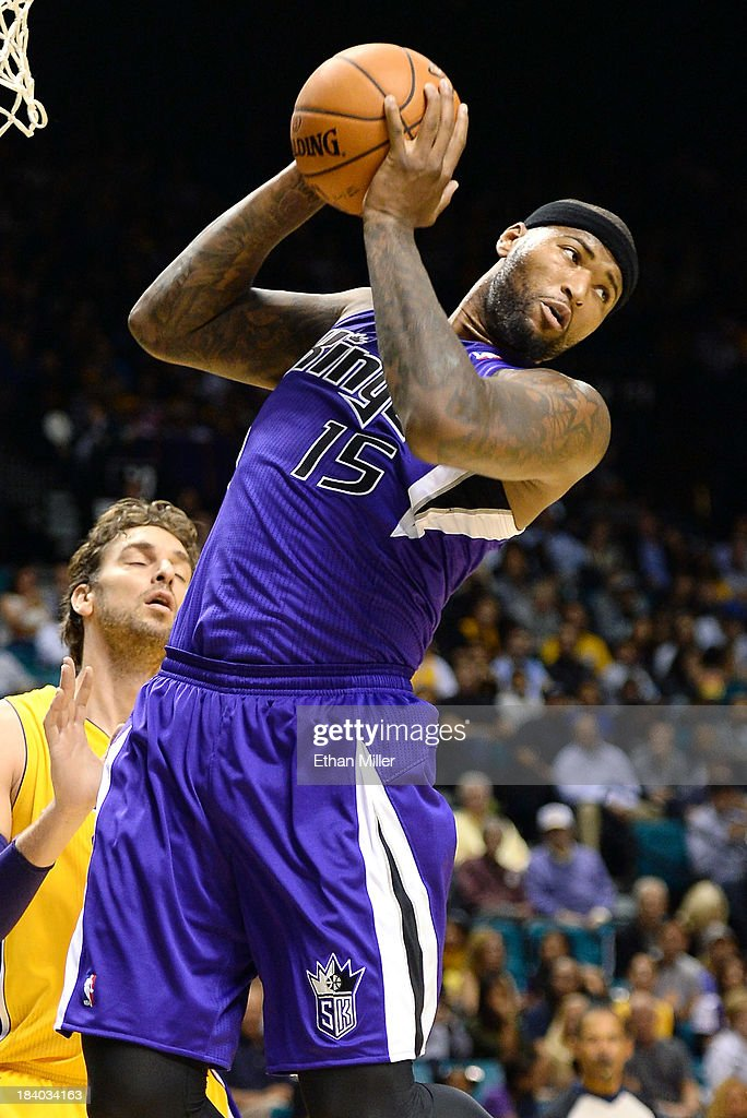 DeMarcus Cousins #15 of the Sacramento Kings grabs a rebound in front of Pao Gasol #16 of the Los Angeles Lakers during their preseason game at the MGM Grand Garden Arena on October 10, 2013 in Las Vegas, Nevada. Sacramento won 104-86.