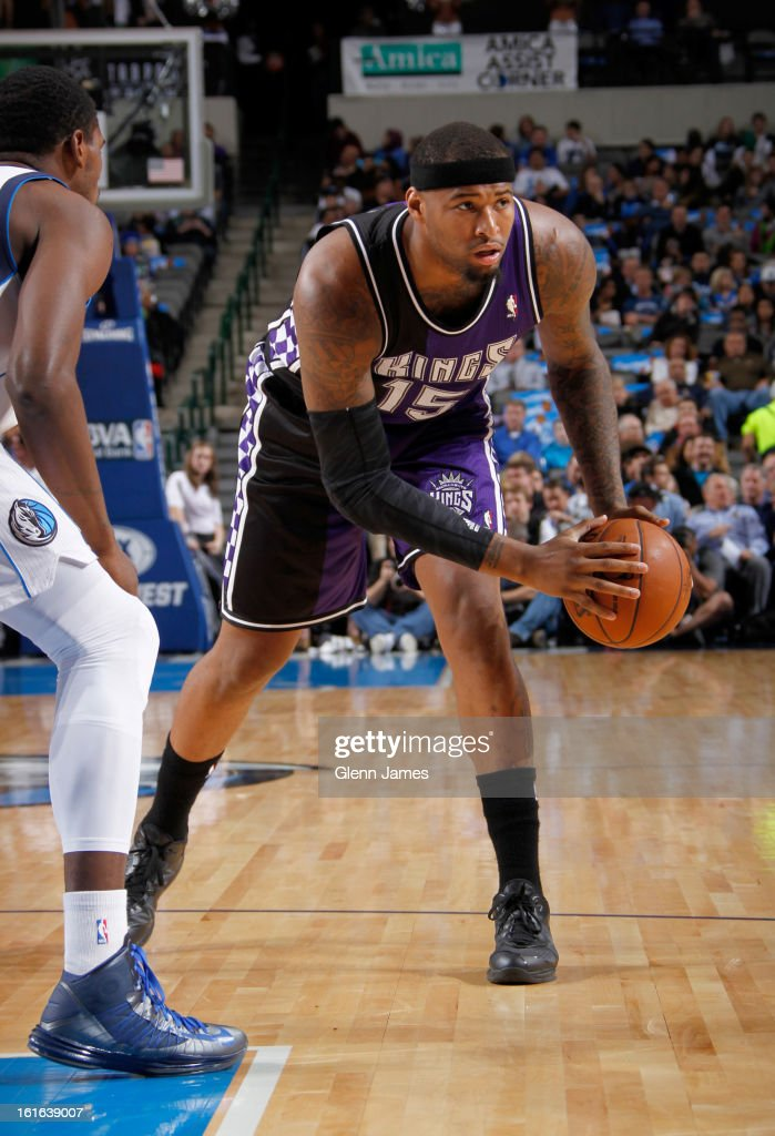 DeMarcus Cousins #15 of the Sacramento Kings handles the ball against Bernard James #5 of the Dallas Mavericks on February 13, 2013 at the American Airlines Center in Dallas, Texas.